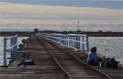 People enjoying One Mile Jetty
